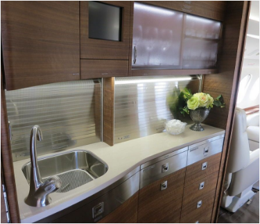 Picture of full pluming installation of a yacht galley with sink and faucet and custom cabinetry.