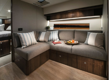 Picture of yacht interior living space with custom cabinetry design and upholstery work.