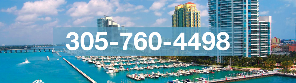 Photo of Miami harbor in mid summer with attached phone number of Miami Boat Repair shop.